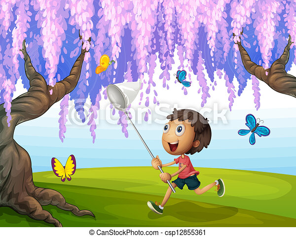 A boy catching butterflies at the park - csp12855361