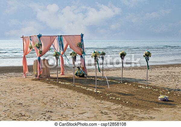 Flower decoration at the beach wedding venue - csp12858108