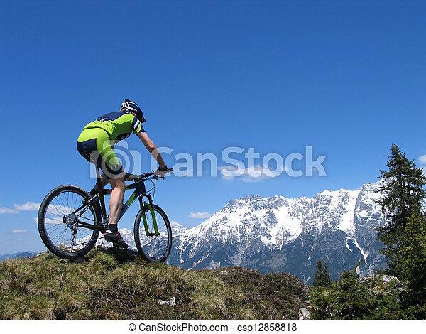 Mountain biker riding through the mountains - csp12858818