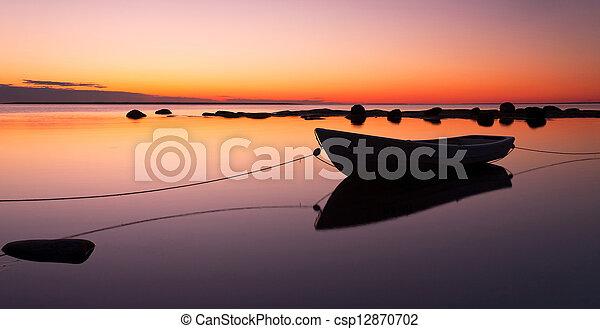 Boat at sunset - csp12870702