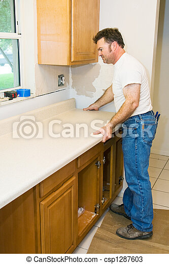Contractor Remodeling Kitchen - csp1287603