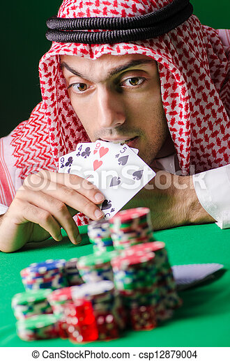 Arab playing in casino - gambling concept with man - csp12879004