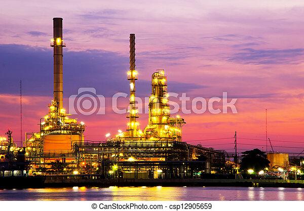 Petroleum oil refinery factory over sunrise - csp12905659
