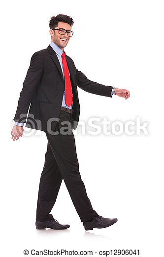man walking sideways & looking at you