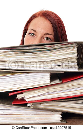 Woman behind a montain of folders in a office - csp12907519