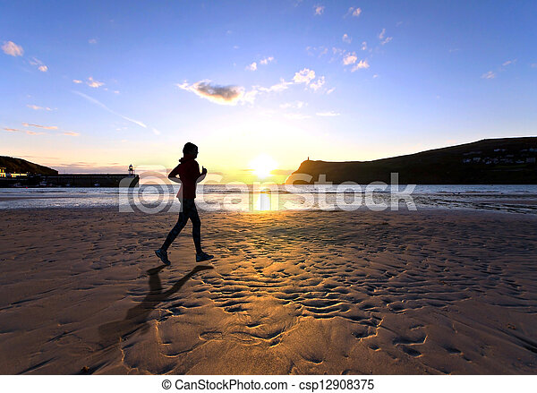 Woman running on a Beach during sunset - csp12908375