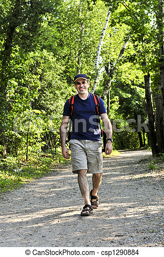 Man walking on forest trail - csp1290884