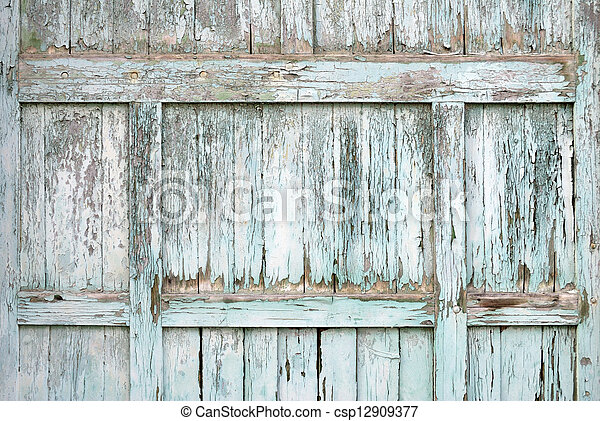 Paint-peeling wooden old door texture detail - csp12909377