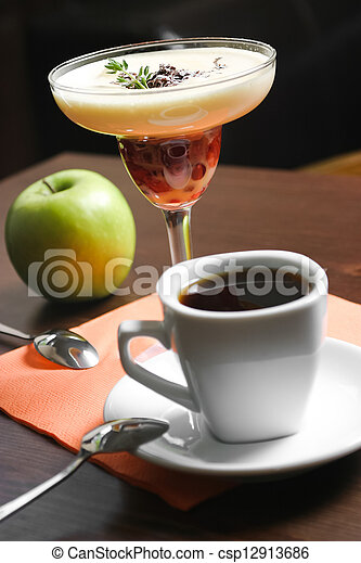 Fruit dessert and cup of coffee - csp12913686