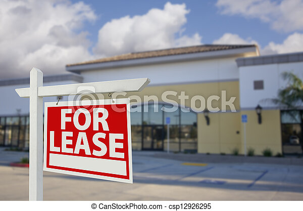 Vacant Retail Building with For Lease Real Estate Sign - csp12926295