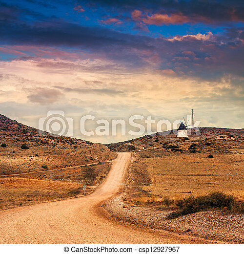 Spanish landscape. Desolate rural area in mountains of Andalusia. Agave plants. Cabo de Gata natural park near Almeria. - csp12927967