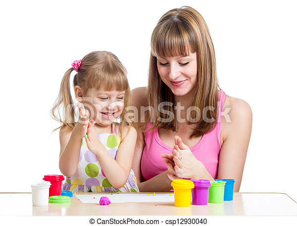 Happy kid girl and mother playing with colorful clay toy - csp12930040