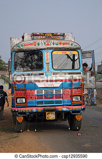 Typical, colorful, decorated public transportation bus in India - csp12935590