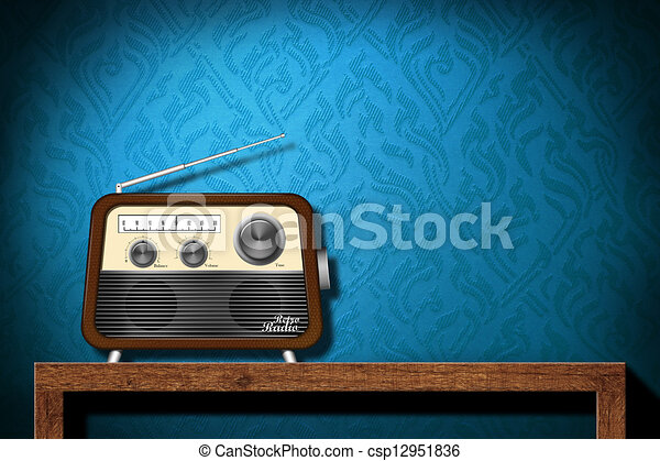 Retro radio on wood table with blue wallpaper background - csp12951836