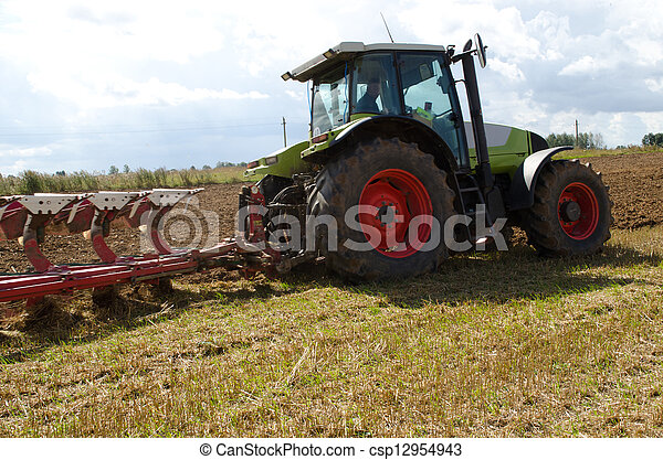 tractor closeup plow furrow agriculture field  - csp12954943
