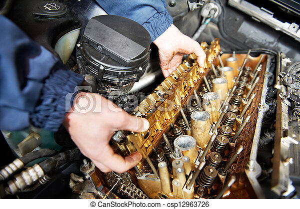 machanic repairman at automobile car engine repair - csp12963726