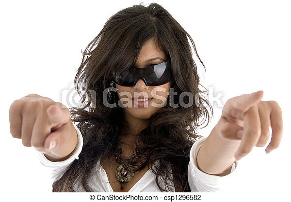 fashion model pointing with both hands - csp1296582