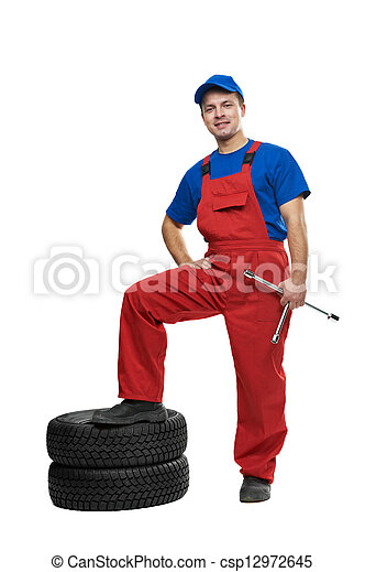 automobile mechanic with car tire and spanner - csp12972645