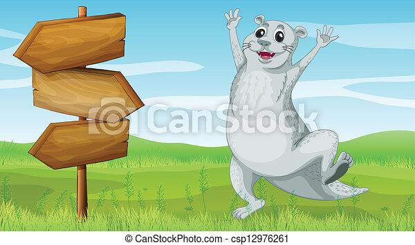 An animal beside a wooden arrow board - csp12976261