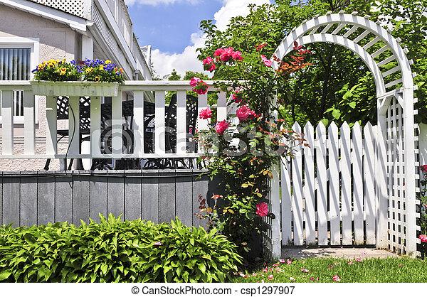White arbor in a garden - csp1297907