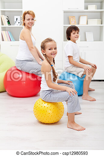 Happy family exercising at home - csp12980593