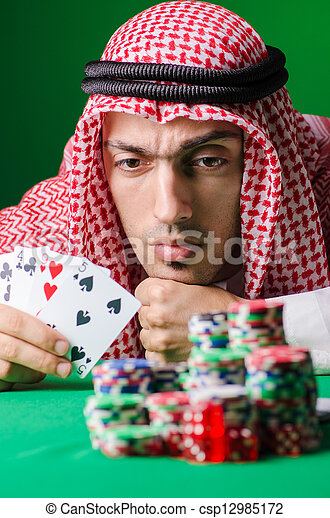 Arab playing in casino - gambling concept with man - csp12985172
