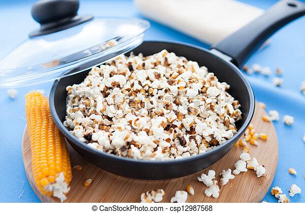 stock bild von popcorn pfanne blaues hintergrund. Black Bedroom Furniture Sets. Home Design Ideas