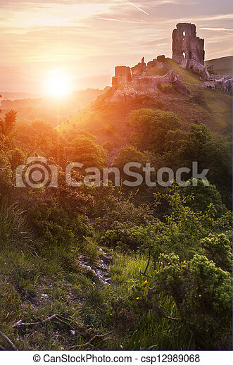 Beautiful dreamy fairytale castle ruins against romantic colorful sunrise - csp12989068