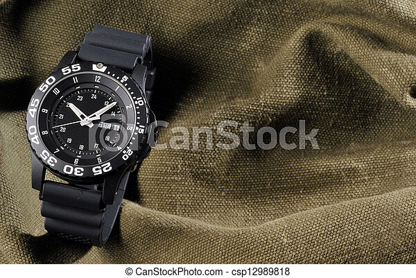 military watch on sack background - csp12989818