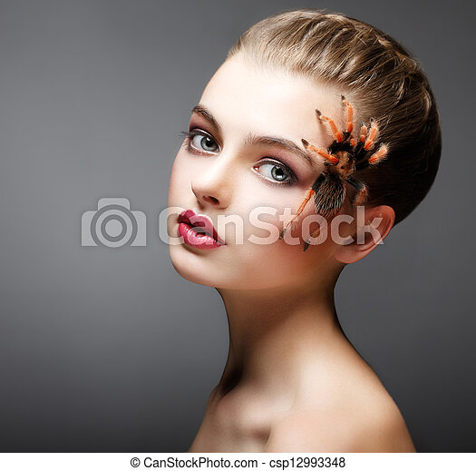 Fantasy. Spider sitting on Pretty Woman Face. Creativity - csp12993348