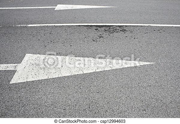 Arrows on asphalt road traffic regulations, safety