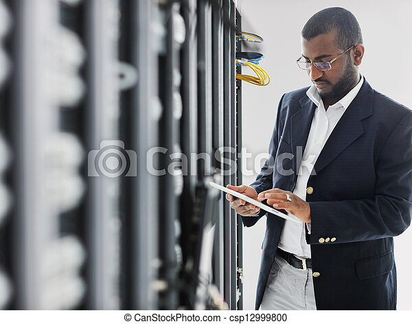 Handsome African American man with tablet computer - csp12999800