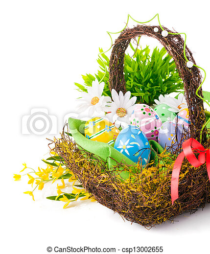 easter eggs in basket with spring flowers - csp13002655