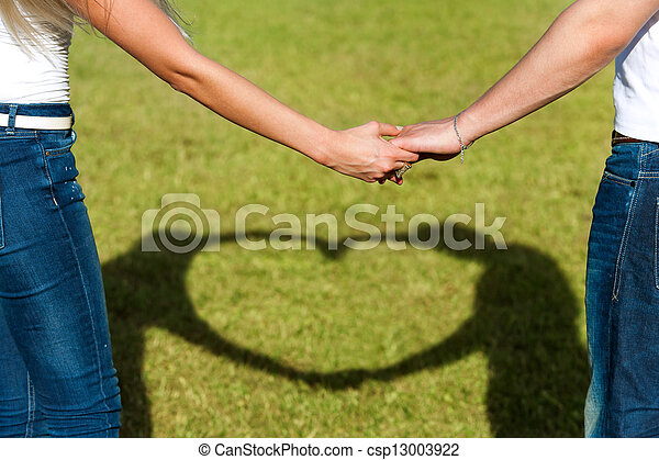 Close up of couples hands together with love sign. - csp13003922