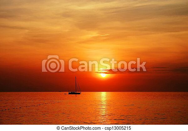 sailing boat sunset at kata beach phuket  - csp13005215