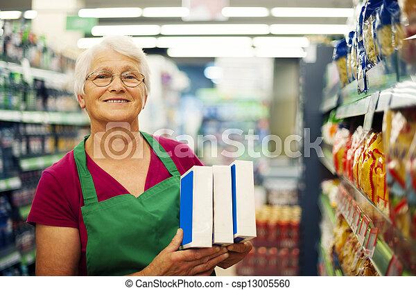 Senior woman working at supermarket  - csp13005560