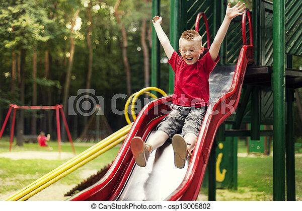 Stock Photography Of Active Boy Sliding Down Csp13005802