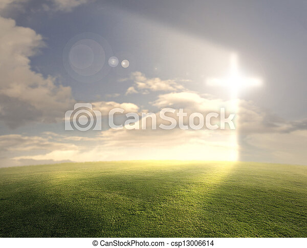 Bright glowing cross on grassy background.
