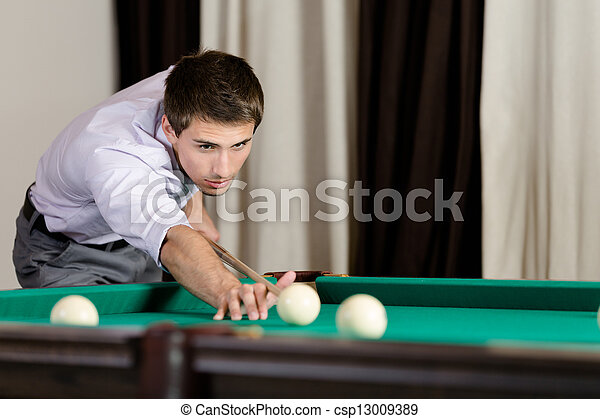 Man playing billiard at gambling house - csp13009389