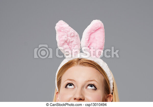 Easter bunny woman looking up - csp13010494