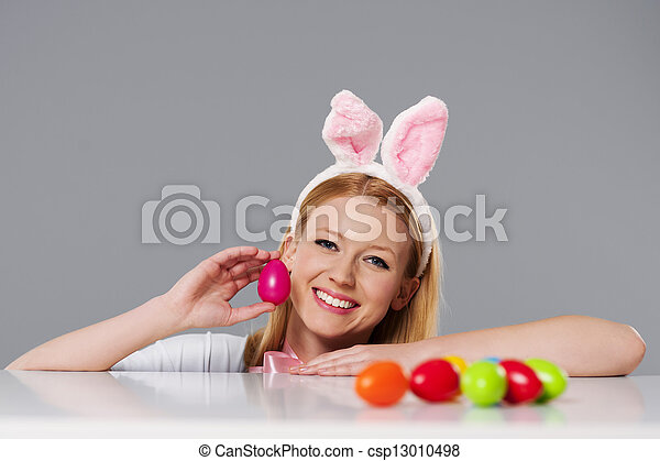 Blonde woman with bunny ears and easter eggs - csp13010498