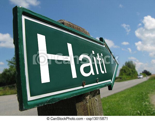 Haiti signpost along a rural road - csp13015871