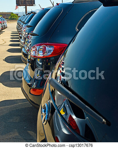 Row of Automobiles on a Car Lot on a Bright Sunny Day - csp13017676