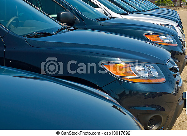 Row of Automobiles on a Car Lot on a Bright Sunny Day - csp13017692
