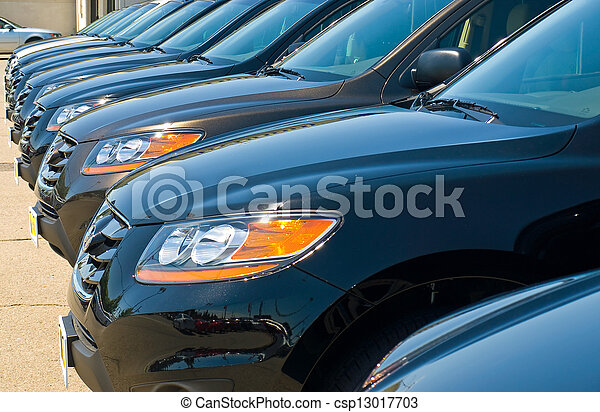 Row of Automobiles on a Car Lot on a Bright Sunny Day - csp13017703