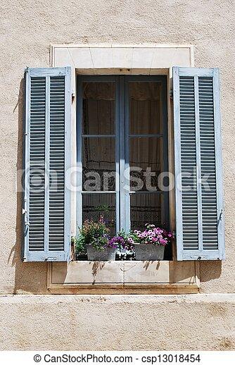 Window with flowers - csp13018454