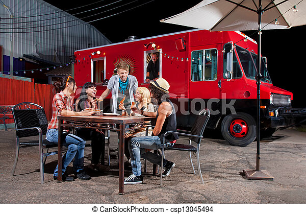 Eating Pizza Near Food Truck - csp13045494