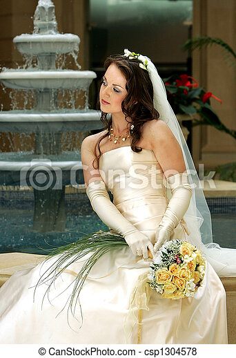 Bride with veil holding bouquet - csp1304578