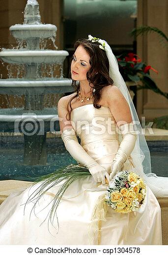 Bride with veil holding bouquet - csp1304578