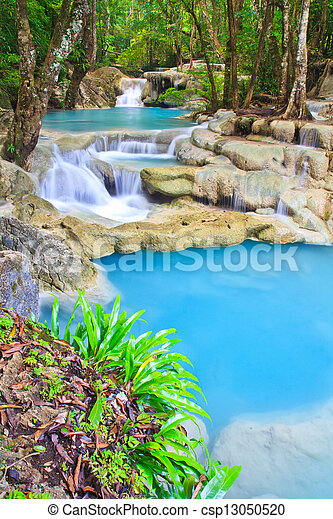 Waterfall and blue stream in the forest Kanjanaburi Thailand - csp13050520